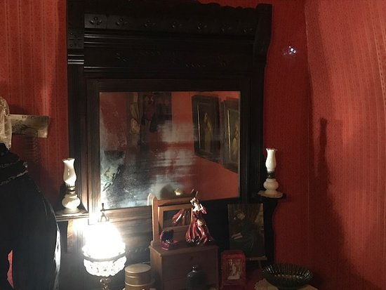 Porterville, CA: A bit of an optical illusion. The mirror has aged and it sort of look likes a man's face. Is that William Brooks in the mirror?