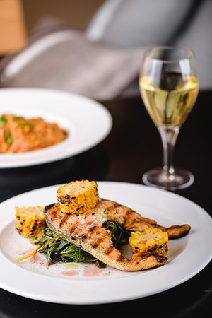 The Pastards : Grilled Salmon served with pomegranate flavored wild green leaf vegetables and grilled corn