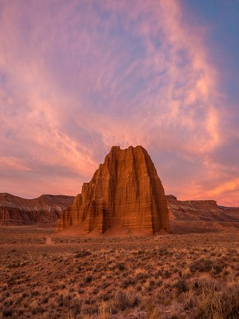 Doran Erickson took this photo of Temple of the Sun in Capitol Reef National Park in Utah. See this rock formation and its smaller companion, Temple of the Moon, by taking Caineville Wash Road from outside of the park. It's a rough road that is possible to drive with a 2wd car, but we recommend a 4wd high-axle vehicle. Because of the necessity to drive slow, expect to spent an hour driving 15 miles to the rock formations in Cathedral Valley, a remote section of the national park.