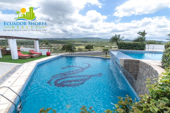Beautiful pool setting with waterfall here at Montecristi Golf Club!