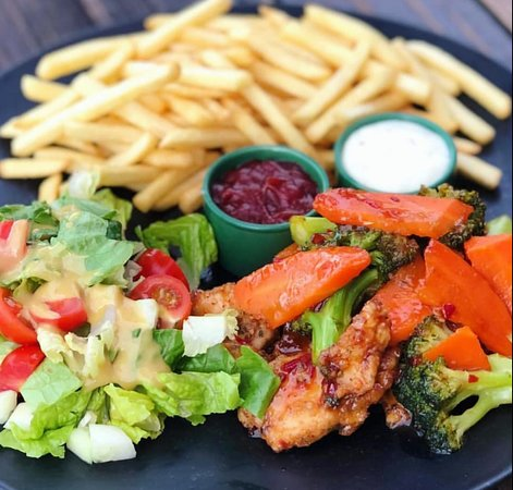 27 Curacao: 27 bar music food Sweet & Sour Chicken w/ fries & salad. Check out our weekspecials!