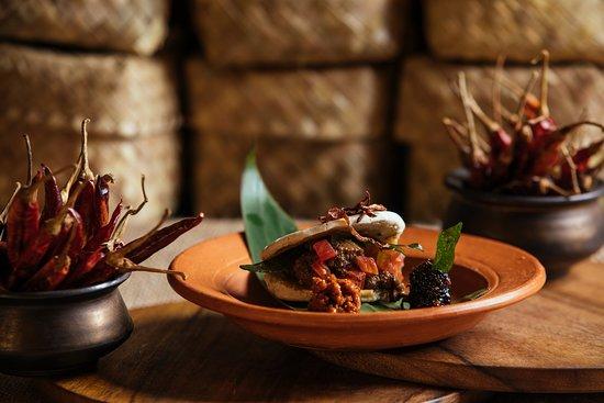 Black pork curry stuffed pol rotti
