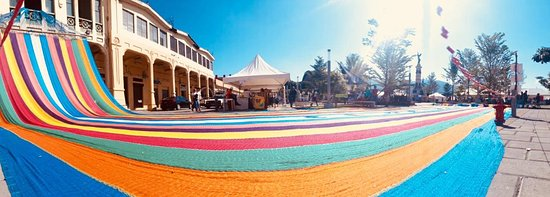 """Chalatenango Department, El Salvador: """"largest hammock."""" In Chalatenango, El Salvador, 400 people in the town of Llano Grande, Concepción Quezaltepeque have worked for 28 consecutive days to weave together an enormous hammock, hoping to break the world record.  The photo of the hammock was taken in the historic center of San Salvador"""