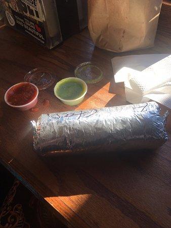 Taqueria El Buen Sabor: Massive burrito with free spicy sauces on the side.