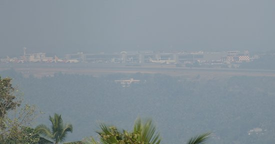 View of the distant Kozhikode Airport runway from Cherupadi Mala