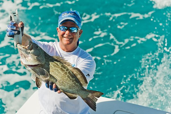 FishMonster Charters: Catching grouper in the crystal clear water off Key West.