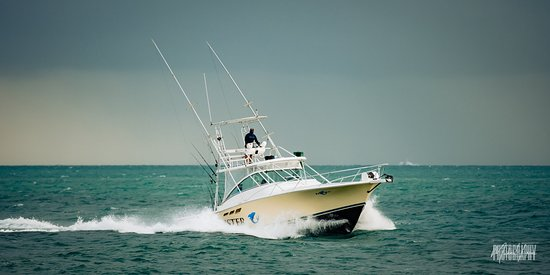 FishMonster Charters: Captain Erik on the Reel Deal heading back into port after a successful day offshore.