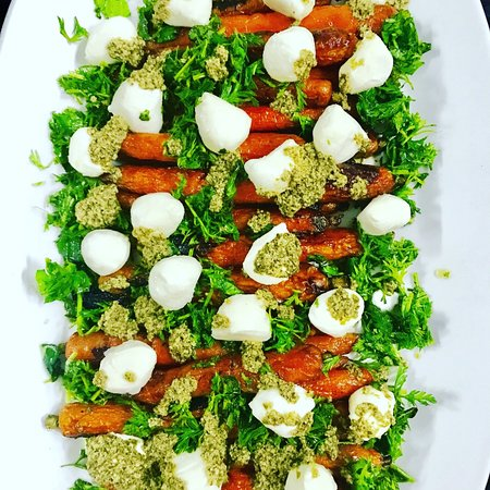 Braised carrots with carrot top pesto and Buratta