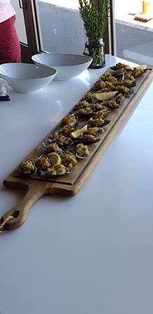 Mussels on half shell with preserved lemon and herb crumb