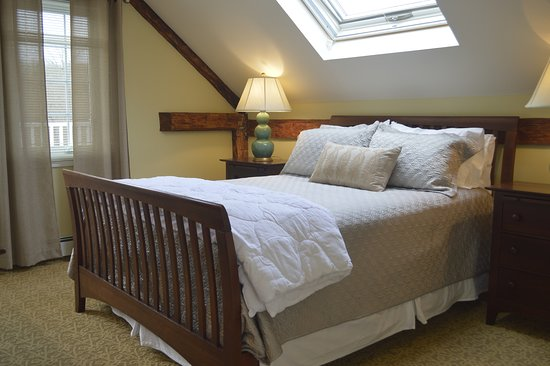 The Winsor House Inn: Winsor Suite: One Queen bed with spacious living area. Private patio overlooking our gardens. The suite includes a bathroom, kitchenette, and private entrance.