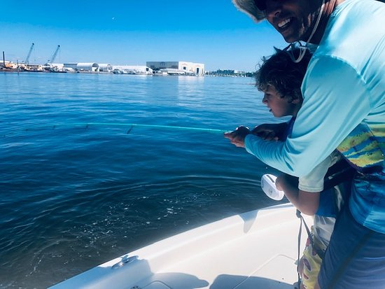 Slay The Bay Fishing Charters Of Tampa Bay : Lenny fighting a fish with his son