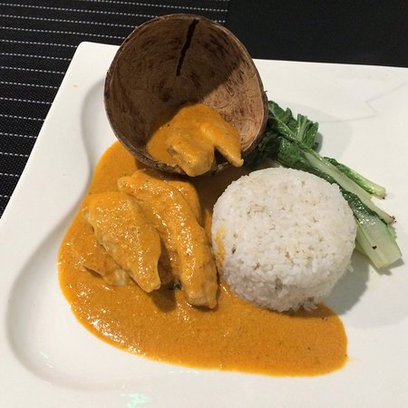 THAI CHICKEN RED CURRY - Chicken or Crab in a spicy red curry sauce.  Served with sautéed pechay and rice.