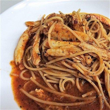 CRAB BOLOGNESE - Spaghetti sautéed with chunks of crab and tomato basil sauce.