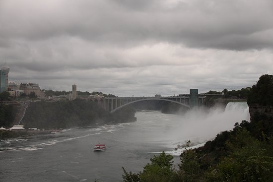 Niagara Falls in One Day: Deluxe Sightseeing Tour of American and Canadian Sides: Rainbow International Bridge with American Falls to right