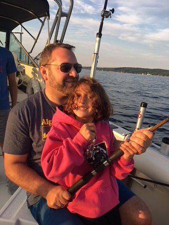 Father, daughter team working a big salmon to the boat!