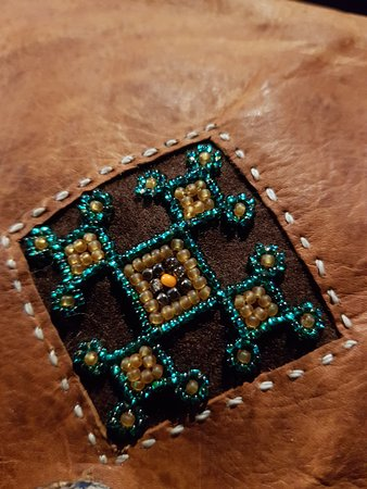 Traditional handcraft from reindeer leather and glass pearls
