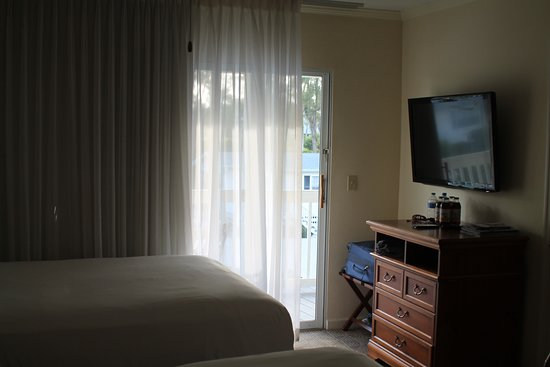 TV opposite one of the queen beds, making viewing from the other bed difficult.  Also, I moved the small dresser so that I could fit the luggage rack in the corner.