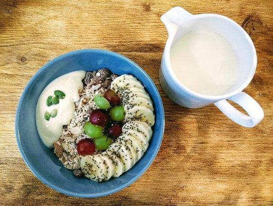 Muesli, fruit, yoghurt & your choice of plant based milk