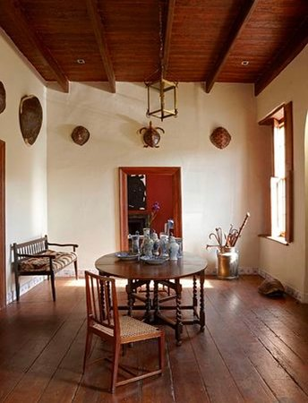 Jonkmanshof: The entrance room decorated with antique tortoise shell, original wooden floors and Karoo style shutters