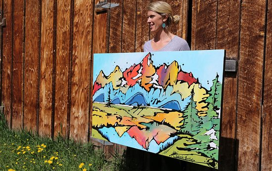 Jackson Hole, WY: The Grand Teton Range, held up by artist Nicole Gaitan.