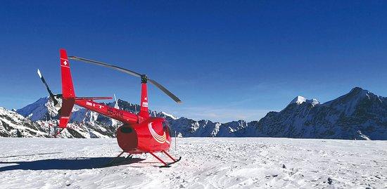 Belp, Switzerland: Robinson R66 helicopter on the glacier Petersgrat.