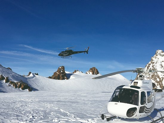Belp, Switzerland: Two Airbus H125 helicopters in the Swiss Alps.
