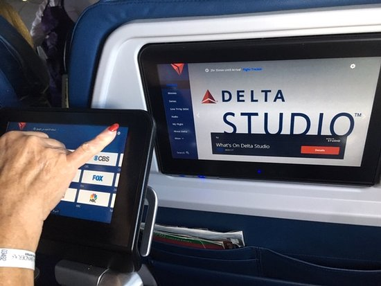 Delta Air Lines: There was a wider armrest on my 'Comfort' section seat but its only purpose was to allow the person sitting next to me  - in the middle seat  - to access their screen which when fully extended interfered with mine. What a joke!