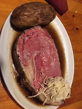 Wobbly Barn Steakhouse: Prime Rib, rare, covering nearly my entire plate, with raw horseradish and a baked potato (toppings on the side)