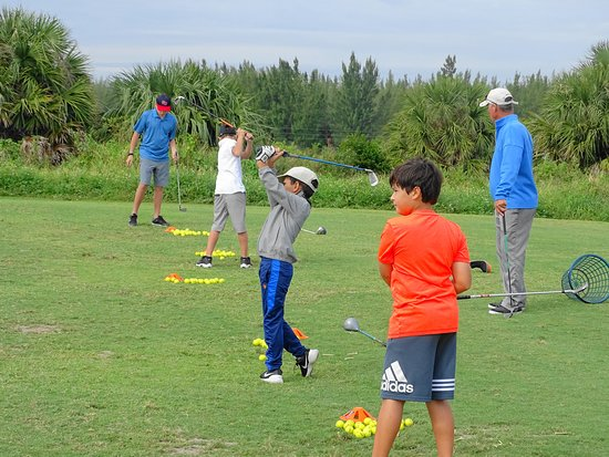 Lake Worth, FL: Coach Glen Beaver teaches a homeschool group golf series at Park Ridge Golf Course.