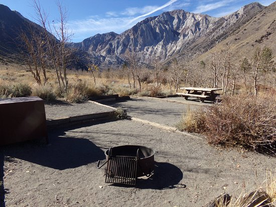 Crowley Lake, CA: Campsite with mountain views by the creek. Ample space for tent pad and camping essentials.