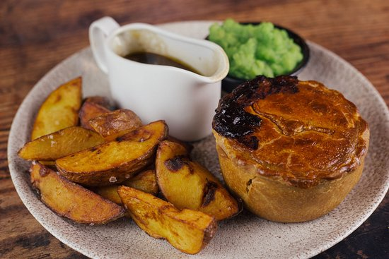 Steak, ale and mushroom pie with hand-cut chips, mushy ...