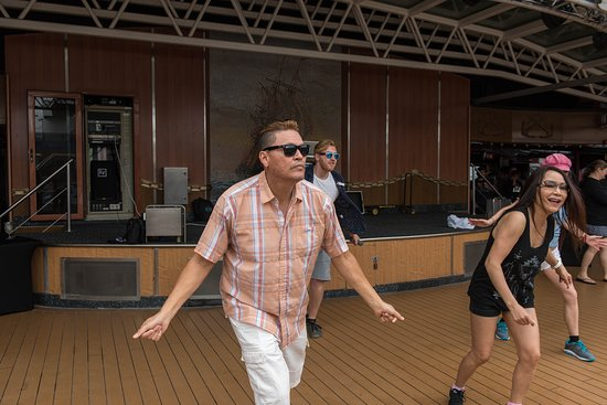 Dance Lessons at the Ulysses Main Pool on Carnival Miracle