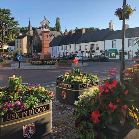 Twyn Square, the centre of Usk in Bloom, in an example of its summer garb.