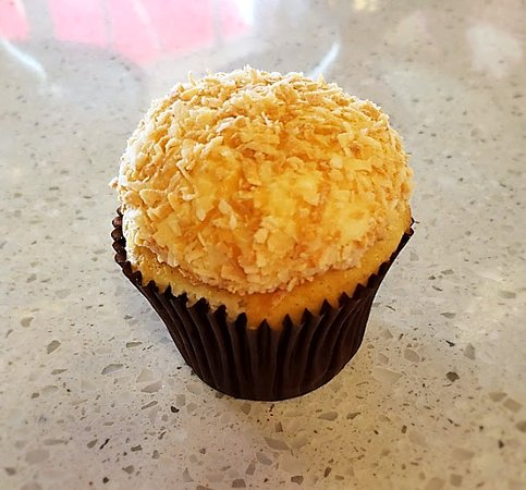 Coconut (Available Daily) ~ Vanilla bean cake with coconut cream cheese frosting, dipped in toasted coconut