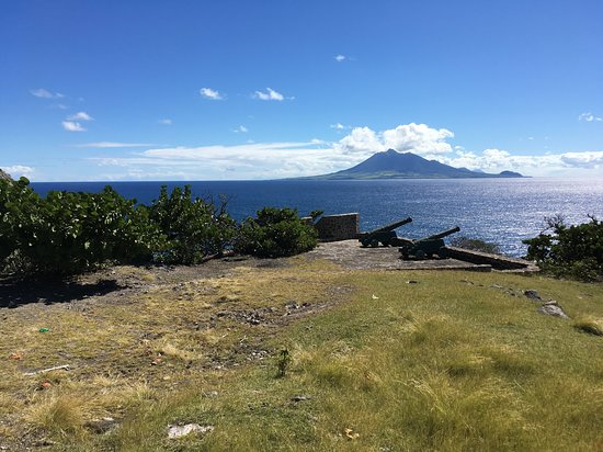 Scubaqua Dive Center: View of St. Kitts and Nevis from south side of Statia.  The peaceful feeling sitting out on this point was incredible.  Atlantic on left, Caribbean on right.