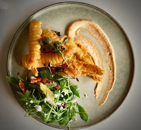 The Landing Cafe: Firm and crunchy battered prawns with fresh garden salad and paprika aioli..