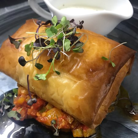 Salmon Fillet in a Crisp Filo Pastry with Garlic & Cream Cheese Leeks, Served with Ratatouille & Dill Cream Sauce