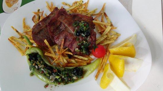 Grillde pork steak with fries ana Chimichouri sauce