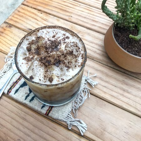 cold brew with coconut milk & chocolate shavings (not sweet)