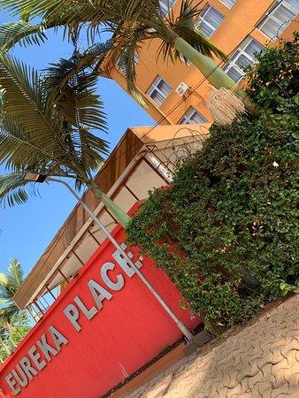 Eureka Place Kampala: The palm trees that surround us i.e. Eureka Place Hotel and Suites.Aw