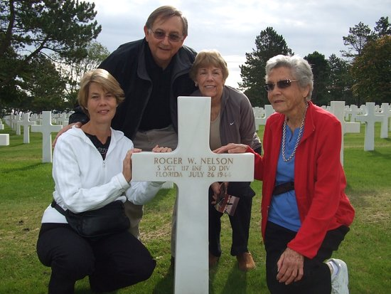 Orglandes, Prancis: At grave of Sgt Roger Nelson KIA St Lo, 7-25-44