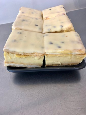 Our homemade vanilla slice with passion fruit icing