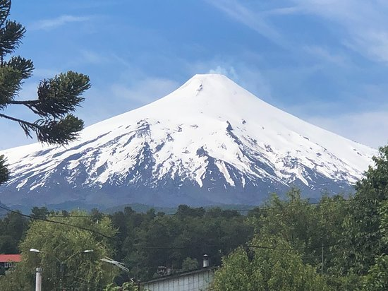 """View from the small town of Pucón to the snow-capped volcano """"Villarrica"""" (2847 m)"""