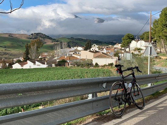 Andalucian Cycling Experience Day Trips: Descent into Montecorto. Grazaleman in distance hidden in late-January clouds.