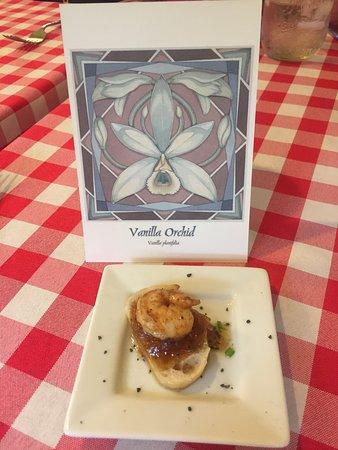 Vanilla shrimp on crostini served on a bed of black Hawaiian salt at the Hawaiian Vanilla Company.