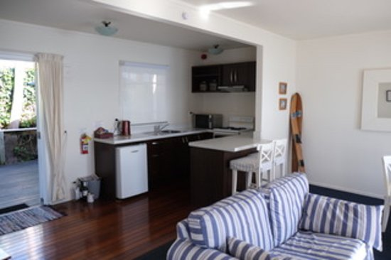 Mangonui Waterfront Apartments: Kitchen seen from lounge area.