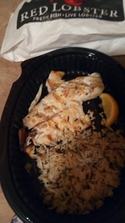 Kentwood, MI: tilapia fish with lobster. The fish came split without the lobster. and a misery of bad looking rice.