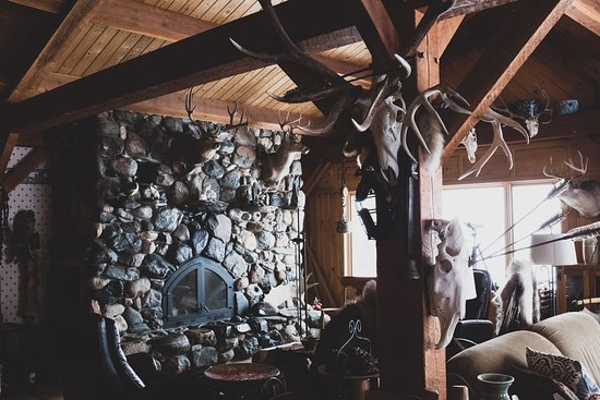 The iconic fireplace at Bowen Lodge has welcomed countless guests and their stories over the years.