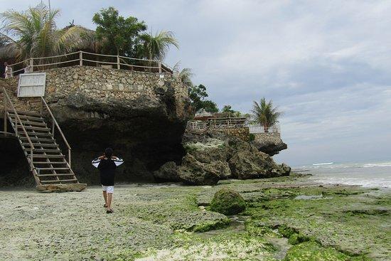 Pantai Kawona : Kawona Beach, a beautiful beach with white sand along the coast. Decorated with rock cliffs that add to the beautiful nature of Kawona.