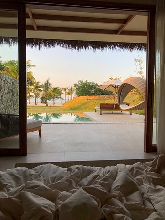 View of the private beach from the bed